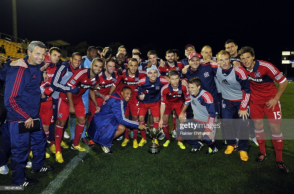 Players and team personnel with the Chicago Fire pose for photographs after winning the Carolina Challenge Cup after a draw against the Vancouver Whitecaps FC at Blackbaud Stadium on February 23, 2013 in Charleston, South Carolina.