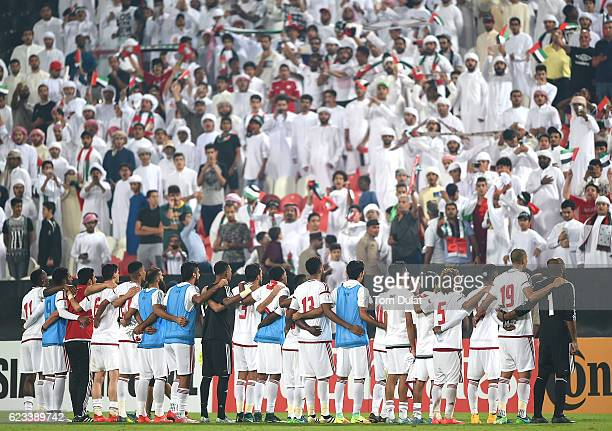 Players and the fans of UAE celebrate after the 2018 FIFA World Cup Qualifier match between UAE and Iraq at Mohamed Bin Zayed Stadium on November 15...