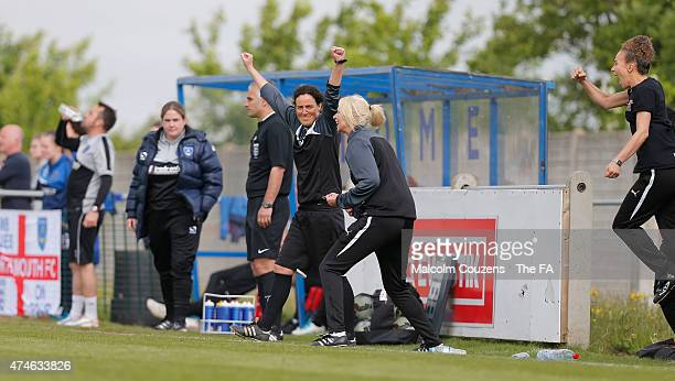 Players and the Sheffield manager Helen Mitchell celebrate at the final whistle for during The WPL Playoff Final between Portsmouth FC Ladies and...