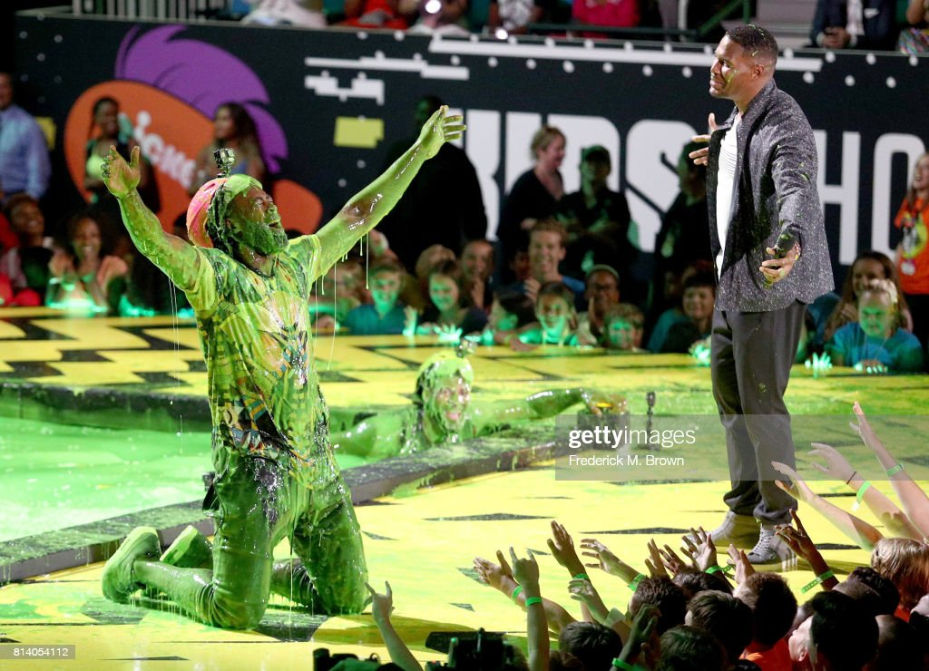 NBA players Andre Drummond and DeAndre Jordan react after getting slimed with TV personality Michael Strahan during Nickelodeon Kids' Choice Sports Awards 2017 at Pauley Pavilion on July 13, 2017 in Los Angeles, California.