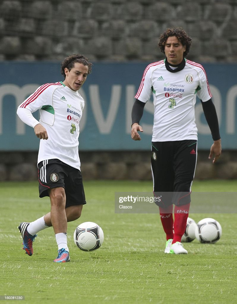 Players <a gi-track='captionPersonalityLinkClicked' href=/galleries/search?phrase=Andres+Guardado&family=editorial&specificpeople=465479 ng-click='$event.stopPropagation()'>Andres Guardado</a> and <a gi-track='captionPersonalityLinkClicked' href=/galleries/search?phrase=Guillermo+Ochoa&family=editorial&specificpeople=490875 ng-click='$event.stopPropagation()'>Guillermo Ochoa</a> fight for the ball during a training session before the match against the United States at the CAR on August 13, 2012 in Mexico City, Mexico.
