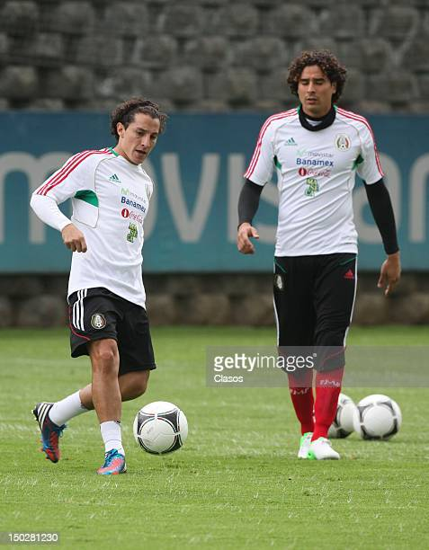 Players Andres Guardado and Guillermo Ochoa fight for the ball during a training session before the match against the United States at the CAR on...