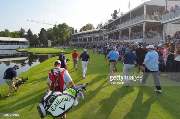 Players approach the 17th hole during the final round of the World Golf ChampionshipsMexico Championship at Club de Golf Chapultepec on March 5 2017...