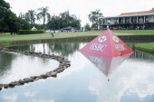 Players approach the 18th green during the second round of the 2014 Brasil Champions Presented by HSBC at the Sao Paulo Golf Club on March 14 2014 in...