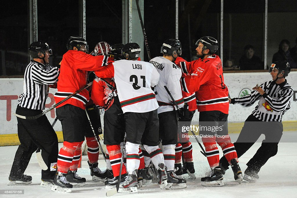 Players are involved in an altercation during the Champions Hockey League group stage game between Briancon Diables Rouges and Frolunda Gothenburg on August 23, 2014 in Briancon, France.