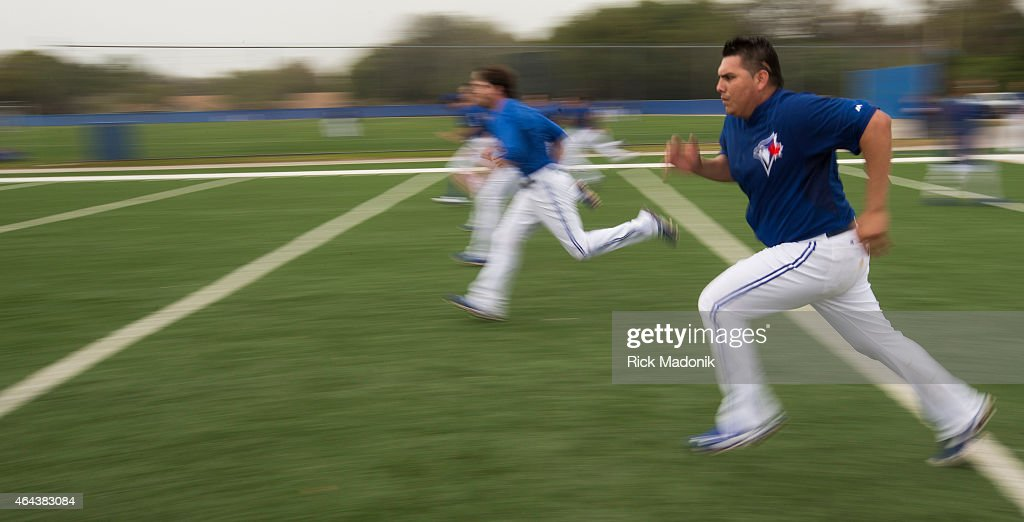 DUNEDIN - FEBRUARY 25 - Players are put through running drills. The Jays work out at the Bobby Mattock Training Facility in Dunedin as the Jays continue spring training preparations for the upcoming MLB Season. Photos from February 25, 2015.
