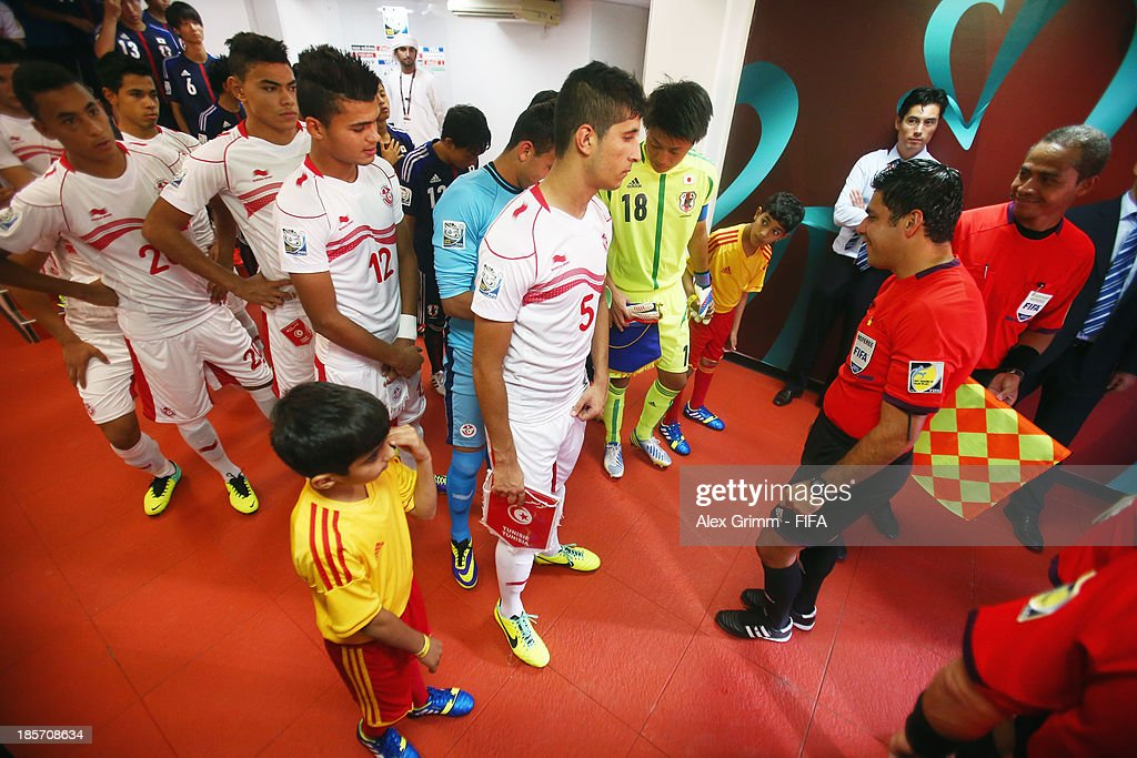 Players are ready to enter the pitch for the FIFA U-17 World Cup UAE 2013 Group D match between Japan and Tunisia at Sharjah Stadium on October 24, 2013 in Sharjah, United Arab Emirates.