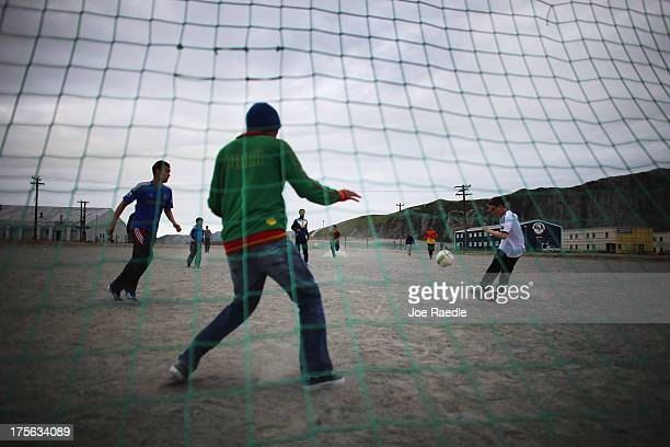 Players are seen as they play a game of soccer on July 09 2013 in Kangerlussuaq Greenland As Greenlanders adapt to the changing climate and go on...