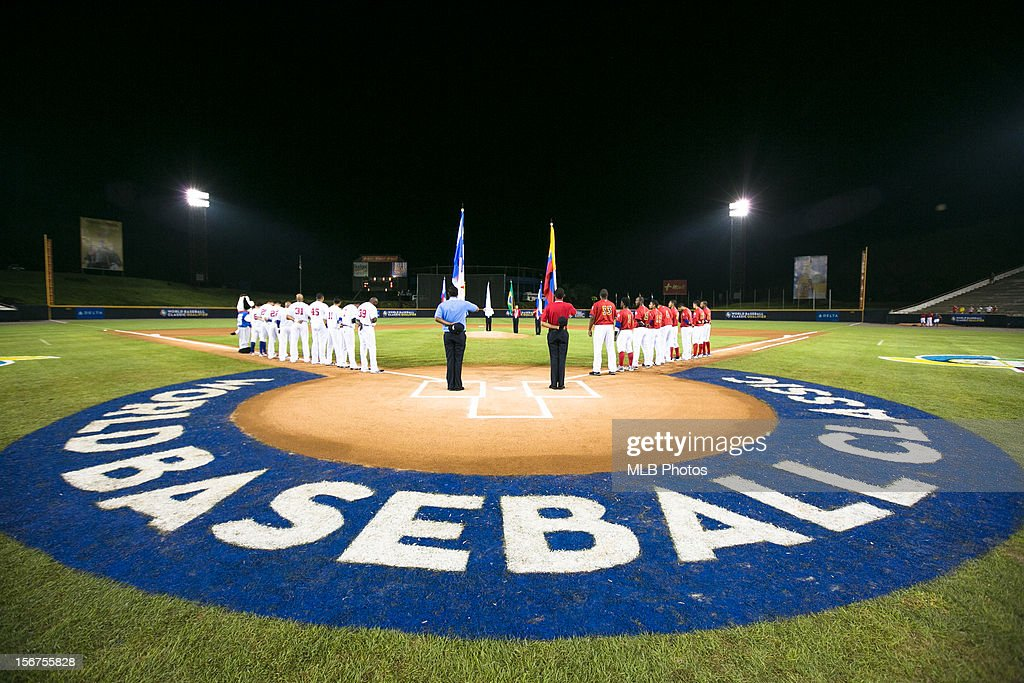 Players are seen on the base paths during the playing of the national anthems before Game 5 of the Qualifying Round of the World Baseball Classic between Team Panama and Team Colombia at Rod Carew National Stadium on Sunday, November 18, 2012 in Panama City, Panama.