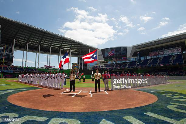 Players are seen on the field during the National Anthem before Pool 2 Game 6 between Team Puerto Rico and Team Dominican Republic in the second...