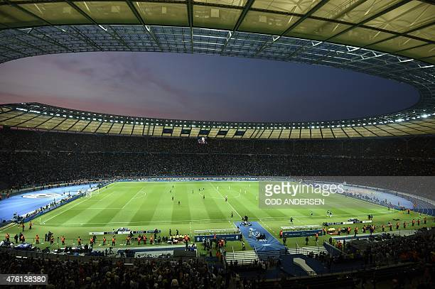 Players are seen on the pitch during the UEFA Champions League Final football match between Juventus and FC Barcelona at the Olympic Stadium in...