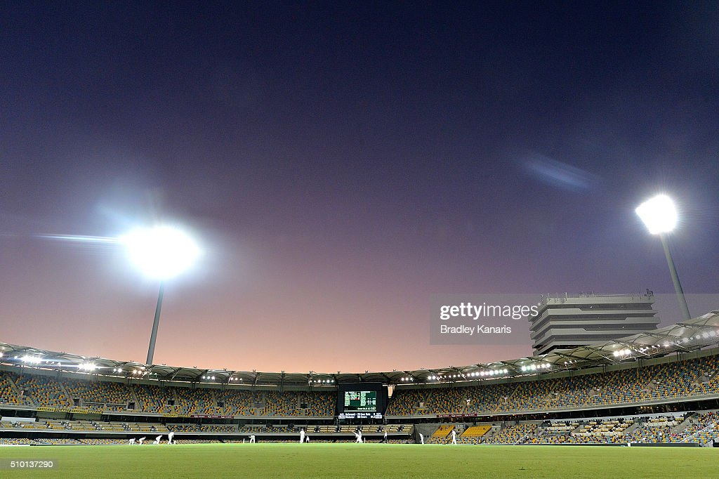 Players are seen playing under lights in day & night cricket with a pink ball for the first time in Sheffield Shield history during day one of the Sheffield Shield match between Queensland and Tasmania at The Gabba on February 14, 2016 in Brisbane, Australia.