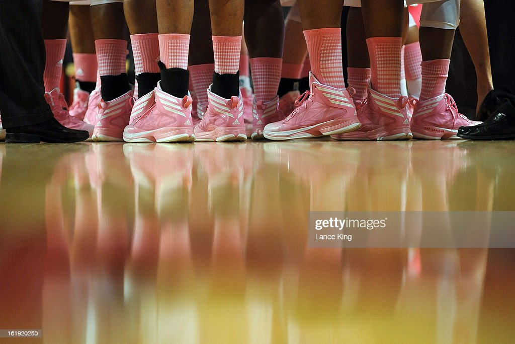 Players are seen wearing pink shoes as part of the 2013 Play 4Kay initiative for breast cancer awareness during a game between the Georgia Tech Yellow Jackets and the North Carolina State Wolfpack at Reynolds Coliseum on February 17, 2013 in Raleigh, North Carolina.