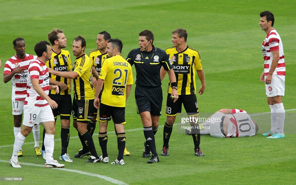 Players argue after Aaron Mooy of the Wanderers was brought down in a tackle by Dani Sanchez of the Phoenix during the round 16 A-League match between the Wellington Phoenix and the Western Sydney Wanderers at Westpac Stadium on January 13, 2013 in Wellington, New Zealand. (Photo by Hagen Hopkins/Getty Images