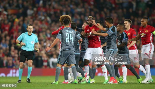Players argue after Manchester United's Eric Bailly clashes with Celta Vigo's Facundo Sebastian Roncaglia
