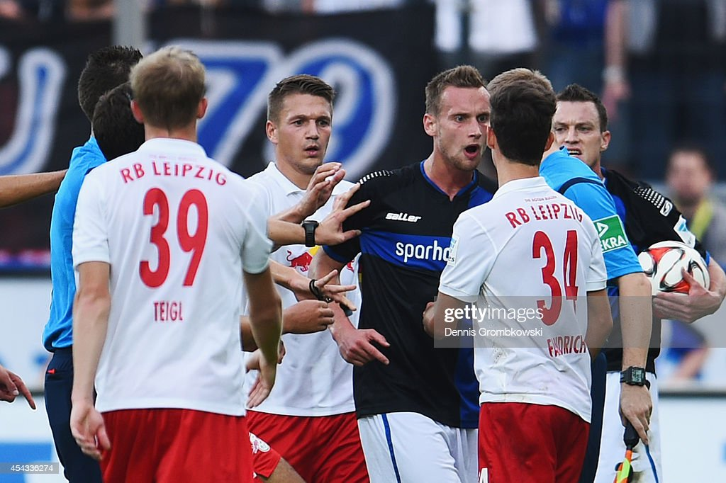 Players argue during the Second Bundesliga match between FSV Frankfurt and RB Leipzig at Volksbank Stadion on August 29, 2014 in Frankfurt am Main, Germany.