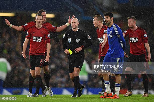 Players argue with referee Anthony Taylor during the Barclays Premier League match between Chelsea and West Bromwich Albion at Stamford Bridge on...