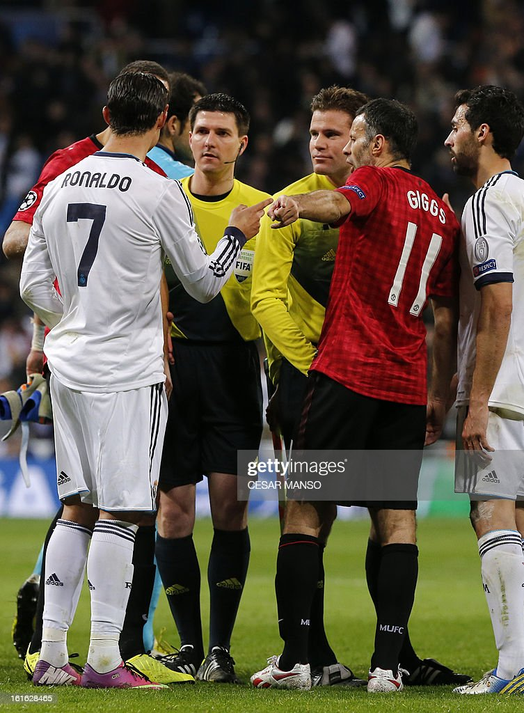Players argue with the referee Felix Brych (3rd R) at the end of the UEFA Champions League round of 16 first leg football match Real Madrid CF vs Manchester United FC at the Santiago Bernabeu stadium in Madrid on February 13, 2013. The match ended in a 1-1 draw. AFP PHOTO / CESAR MANSO
