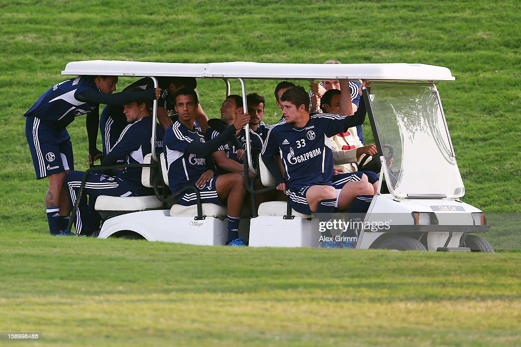 Players arrive in a golf cart for a Schalke 04 training session at the ASPIRE Academy for Sports Excellence on January 5, 2013 in Doha, Qatar.