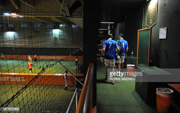 Players arrive to compete a fiveaside football match on April 24 2013 in Puteaux outside Paris AFP PHOTO PIERRE ANDRIEU