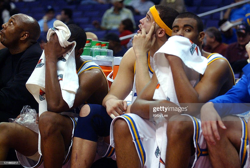 UCLA players (from left) <a gi-track='captionPersonalityLinkClicked' href=/galleries/search?phrase=Arron+Afflalo&family=editorial&specificpeople=640861 ng-click='$event.stopPropagation()'>Arron Afflalo</a>, Michael Ffefy and <a gi-track='captionPersonalityLinkClicked' href=/galleries/search?phrase=Josh+Shipp&family=editorial&specificpeople=640856 ng-click='$event.stopPropagation()'>Josh Shipp</a> sit on the bench dejectedly in the final minute of 79-72 first-rouond loss to Oregon State in the Pacific Life Pac-10 men's basketball tournament at the Staples Center in Los Angeles, California on Thursday, March 10, 2005.