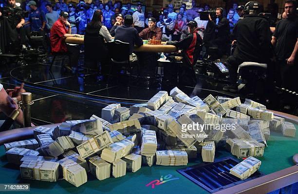 Players at the final table of the World Series of Poker nolimit Texas Hold 'em main event look back at a display of USD 12 million on display at the...