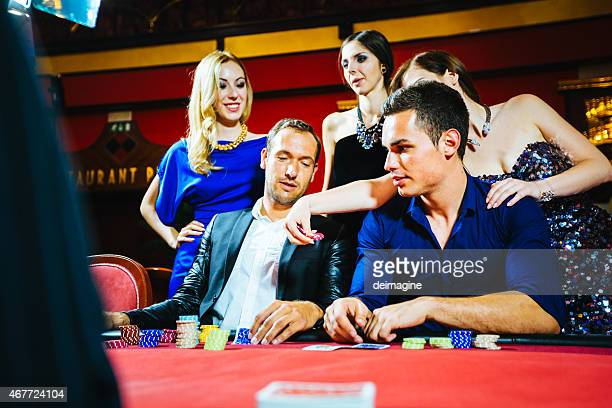 Players at the poker table in the casino