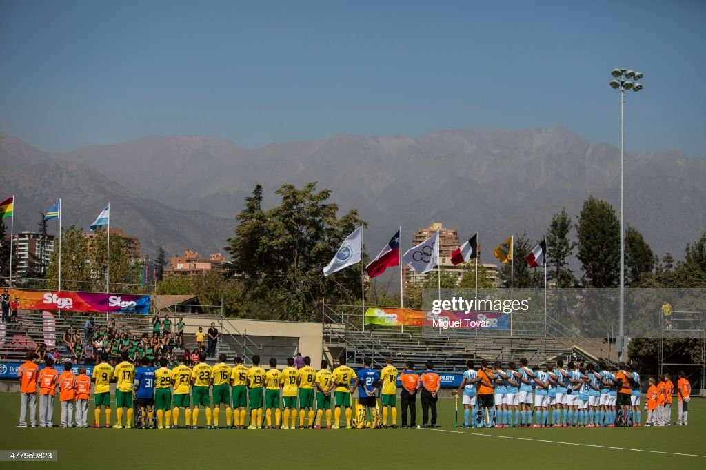 Players attend the national anthems ceremony during a hockey match between Brazil and Argentina as part of day five of the X South American Games Santiago 2014 at Club Manquehue on March 11, 2014 in Santiago, Chile.