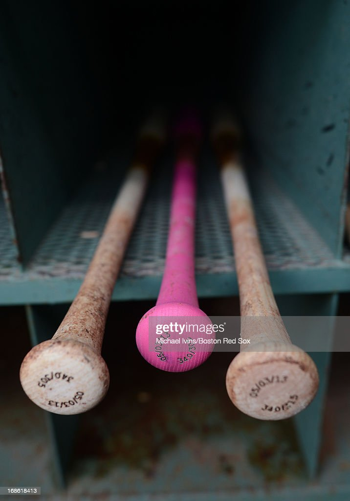 Players bats in the Red Sox dugout come in a pink option before a game between the Boston Red Sox and the Toronto Blue Jays in honor of Mother's Day and breast cancer awareness on May 12, 2013 at Fenway Park in Boston, Massachusetts.