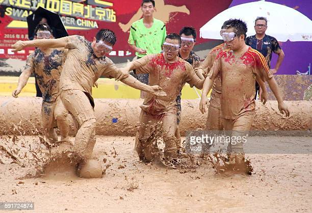 Players battle for a ball in Swamp Soccer World Cup at Yuetan park on August 17 2016 in Beijing China Started on August 13 in Beijing the 2016 Swamp...