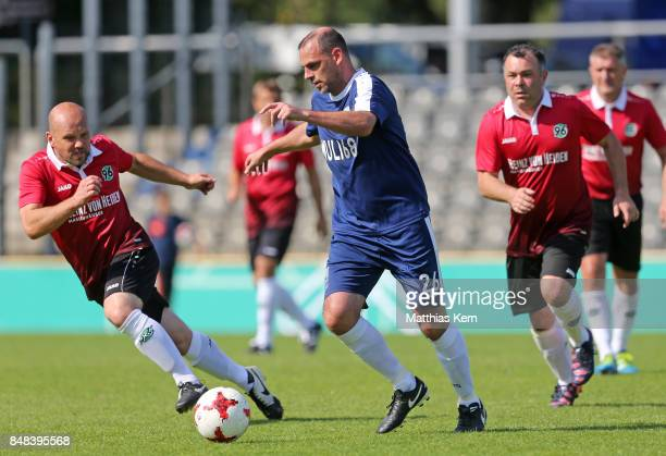 Players battle for the ball during the half final match between SpVg Blau Weiss 1890 and Hannover 96 during the DFB over 40 and 50 cup at...