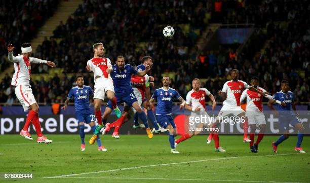 Players battle for the ball from a corner during the UEFA Champions League Semi Final first leg match between AS Monaco v Juventus at Stade Louis II...