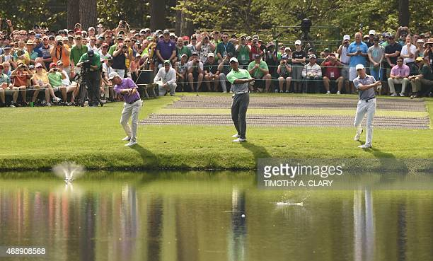 US players Ben Crenshaw Tiger Woods and Jordan Spieth skip balls on the water at the 16th hole during a practice round for he 79th Masters Golf...