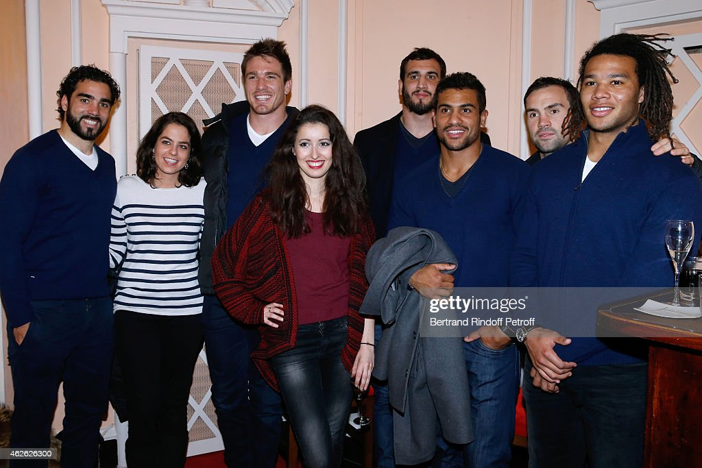 Players Bernard Le Roux (3rd L), Wesley Fofana (3rd R), Teddy Thomas (R), Yoann Huget (L), Actresses Baya Rehaz (4th L) and Anouchka Delon (2nd L) attend France Rugby Team for '2015, 6 Nations Tournament' is Guest of Honor at Hibernatus Theater Play on January 31, 2015 in Paris, France.