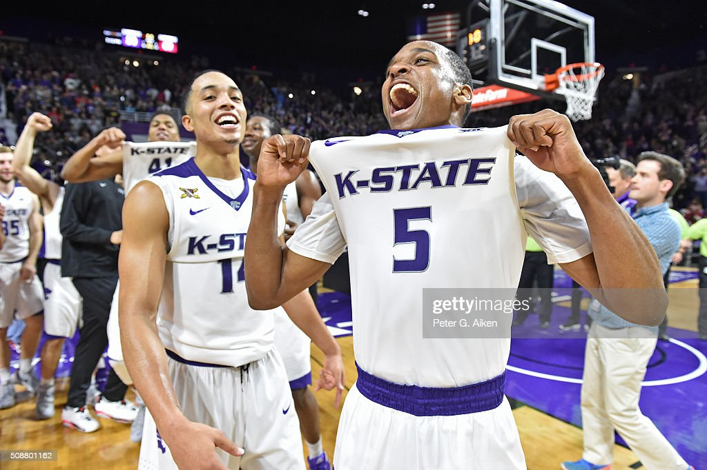 Players Berry Brown and Justin Edwards of the Kansas State Wildcats celebrate after defeating the number one ranked Oklahoma Sooners on February 6...