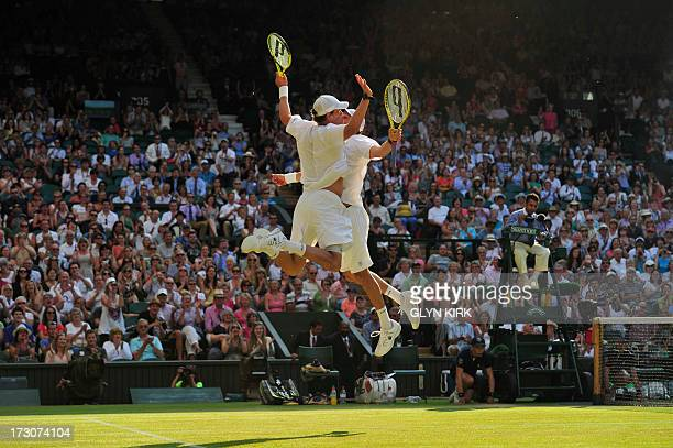 US players Bob and Mike Bryan do their trademark chest bump celebration after beating Croatia's Ivan Dodig and Brazil's Marcelo Melo in the men's...