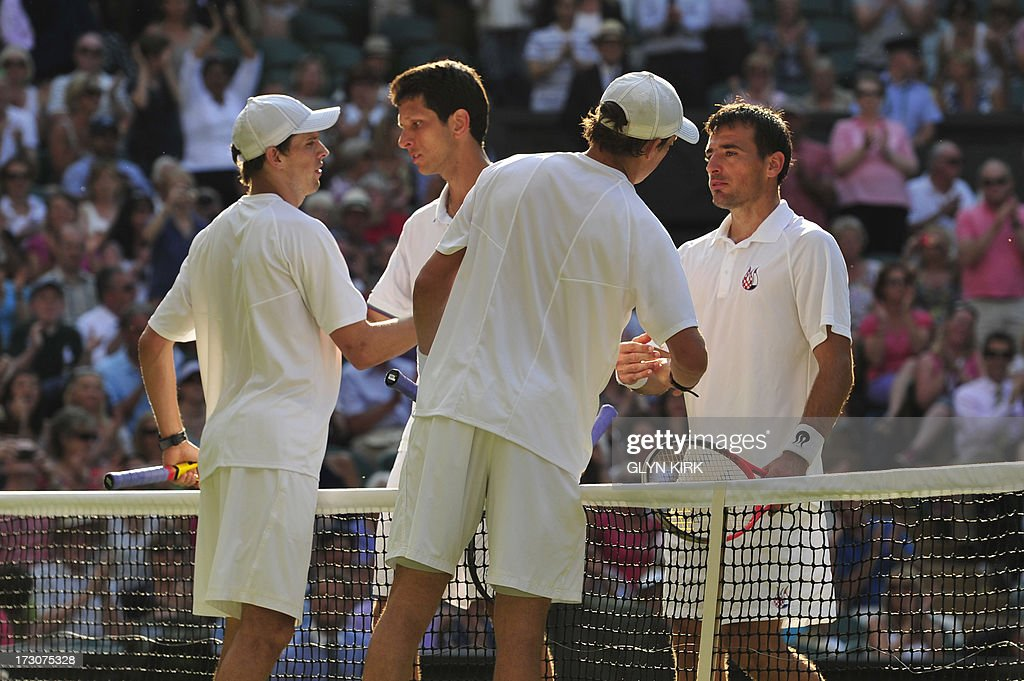 US players Bob (2R) and Mike (L) Bryan shake hands with Croatia's Ivan Dodig (R) and Brazil's Marcelo Melo (2L) after winning the men's doubles final match on day twelve of the 2013 Wimbledon Championships tennis tournament at the All England Club in Wimbledon, southwest London, on July 6, 2013.