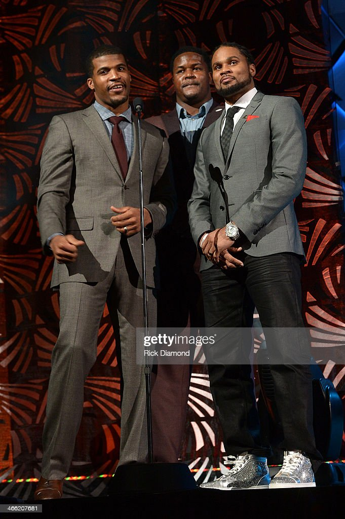 NFL players Brad Smith Bryant Mckinnie and Josh Cribbs speak onstage at the Super Bowl Gospel Celebration 2014 at The Theater at Madison Square...