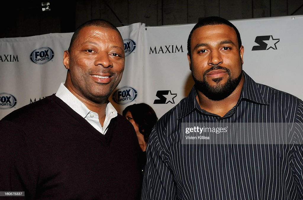 NFL players <a gi-track='captionPersonalityLinkClicked' href=/galleries/search?phrase=Carl+Banks&family=editorial&specificpeople=591658 ng-click='$event.stopPropagation()'>Carl Banks</a> and Duane Brown pose on the Starter Red Carpet at the Maxim Party during Super Bowl XLVII at Second Line Warehouse on February 2, 2013 in New Orleans, Louisiana.