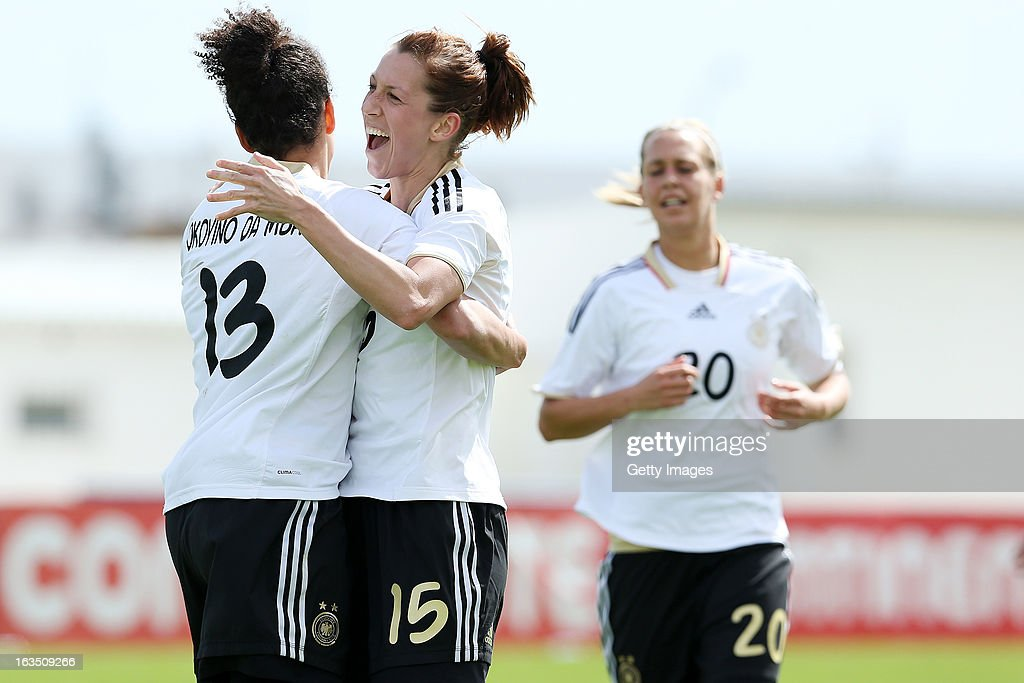 Players celebrate a goal by Celia Okoyino Da Mbabi #13 of Germany during the Algarve Cup 2013 match between Norway and Germany at the Estadio Municipal de Lagos on March 11, 2013 in Lagos, Portugal.