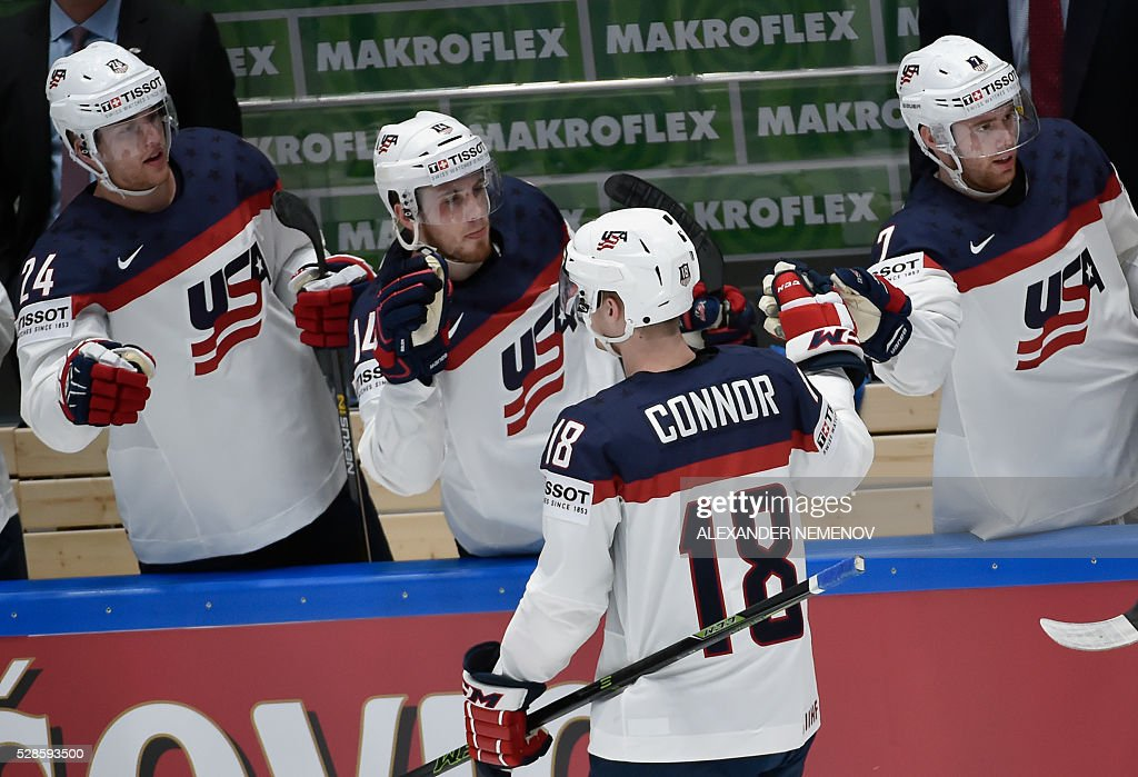 US players celebrate a goal during the group B preliminary round game USA vs Canada at the 2016 IIHF Ice Hockey World Championship in St. Petersburg on May 6, 2016. / AFP / ALEXANDER