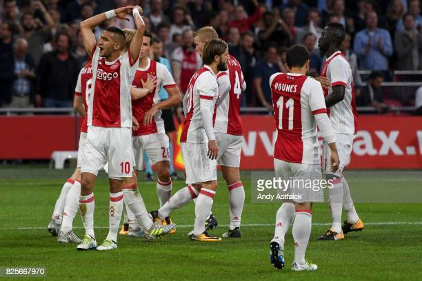 AJAX players celebrate a goal during the UEFA Champions League Qualifying Third Round Second Leg match between AJAX Amsterdam and OSC Nice at...