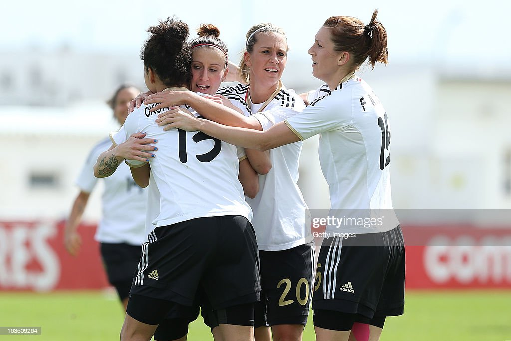 Players celebrate a goal from Celia Okoyino Da Mbabi #13 of Germany during the Algarve Cup 2013 match between Norway and Germany at the Estadio Municipal de Lagos on March 11, 2013 in Lagos, Portugal.