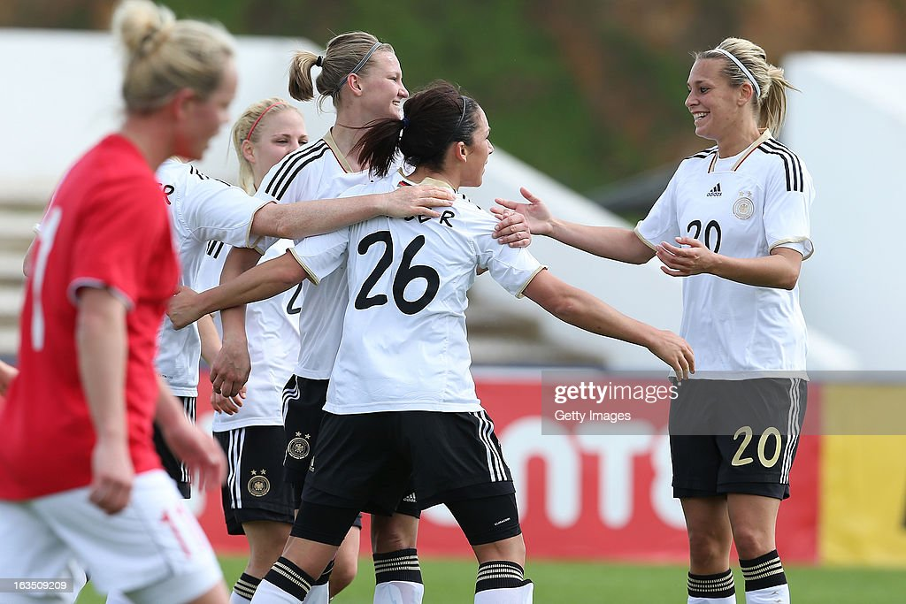 Players celebrate a goal from Nadine Kebler of Germany during the Algarve Cup 2013 match between Norway and Germany at the Estadio Municipal de Lagos on March 11, 2013 in Lagos, Portugal.