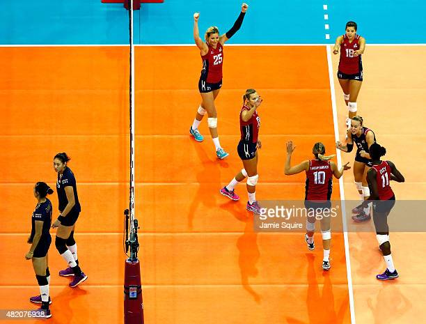 USA players celebrate after a point during the final round match against China on day 5 the FIVB Volleyball World Grand Prix on July 26 2015 in Omaha...