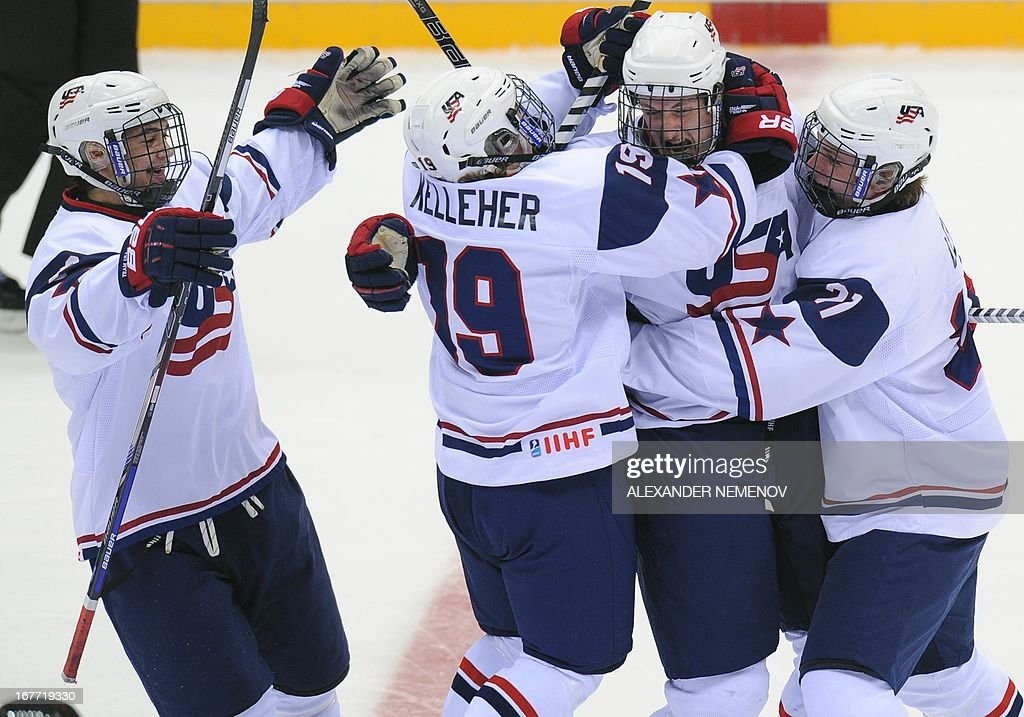 US players celebrate after scoring against Canada during the IIHF U18 International Ice Hockey World Championships final game in Sochi on April 28, 2013.
