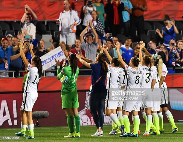 US players celebrate after their win over China in the 2015 FIFA Women's World Cup quarterfinal match at Lansdowne Stadium in Ottawa Ontario on June...