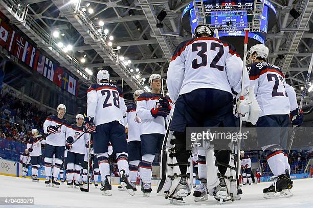 US players celebrate after winning the Men's Ice Hockey Quarterfinals match between the USA and the Czech Republic at the Shayba Arena during the...
