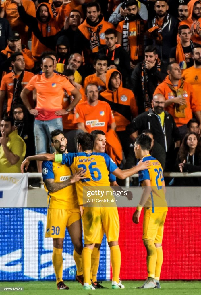 APOEL players celebrate at the end of the UEFA Champions League football match between Apoel FC and Borussia Dortmund at the GSP Stadium in the Cypriot capital, Nicosia on October 17, 2017. /