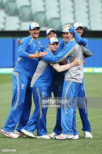 Players celebrate during a training drill during an Australian nets session at Adelaide Oval on November 22 2016 in Adelaide Australia